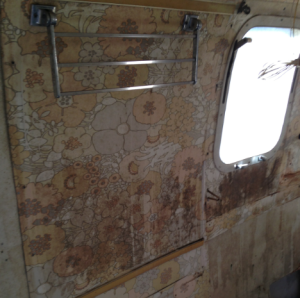 The Airstream certainly needs some beautifying, but hey, that vintage will paper isn't too bad!