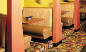This is an example of the type of seating we want the trailer. However instead of 4 people these booths will seat 2 and then there will be one big booth seating 8.