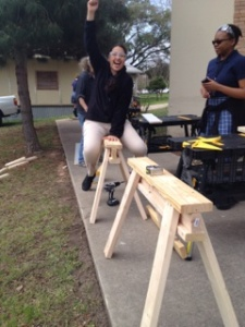 Itzel is super excited about the sawhorses she helped build!