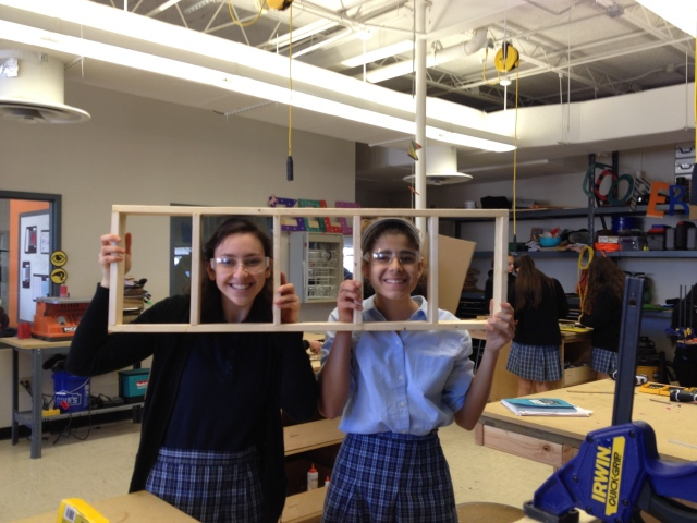 Shahar and I model off the back wall of our greenhouse model.