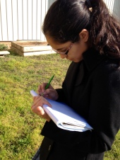 Classmate, Shilah, maps out the around the garden.