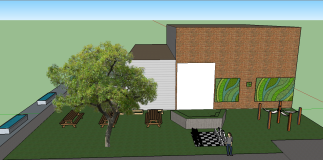 This is the side view of the courtyard featuring the amphitheater, living wall, chess board, hammocks, and picnic tables.