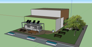 This is a view of the courtyard featuring the airstream with a solar powered roof, picnic tables, and the three ponds.