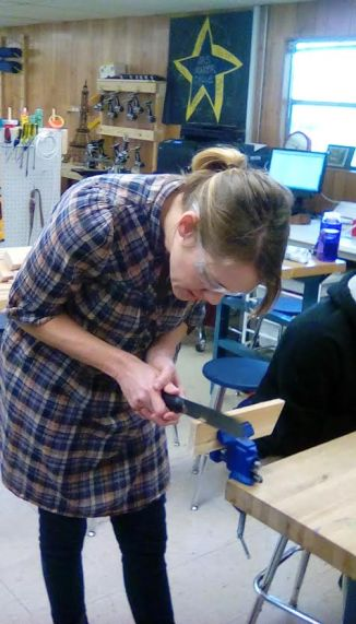Ms Jo demonstrating how to use a pull saw.