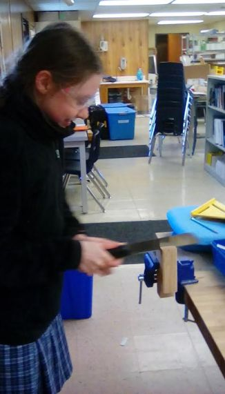 Karen trying out the pull saw.